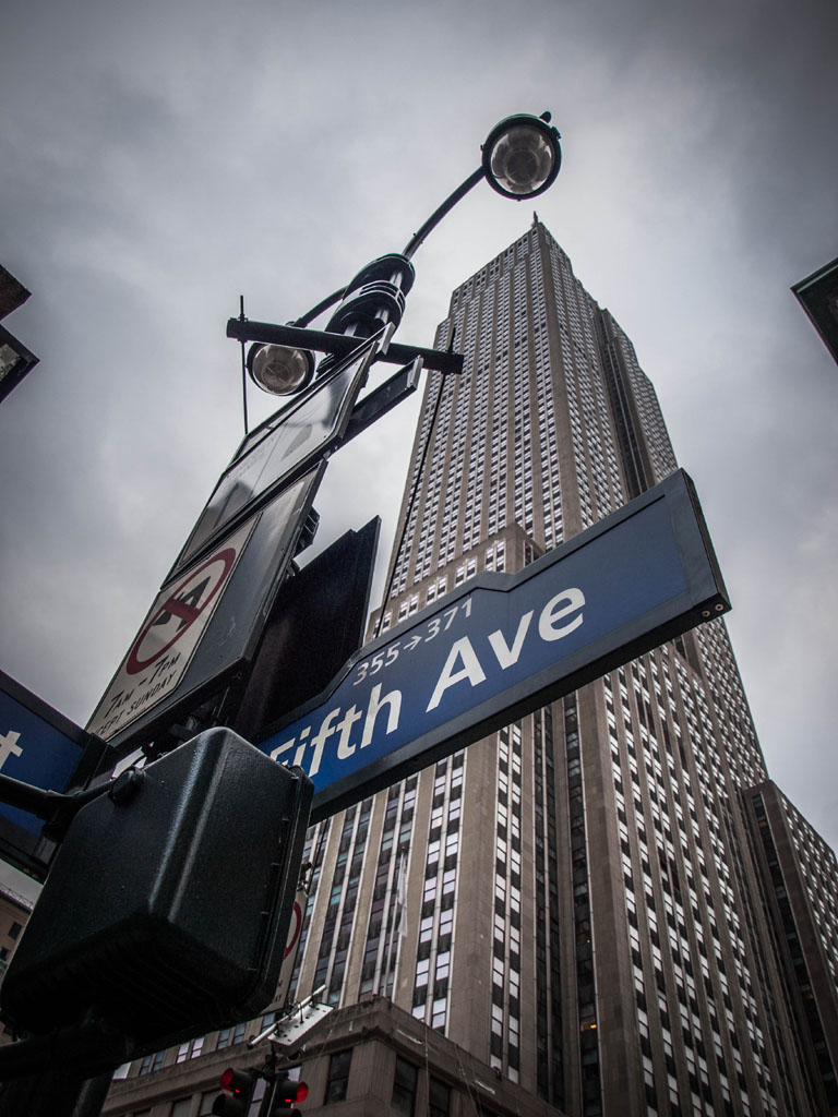 5th Avenue Street sign at empire state building
