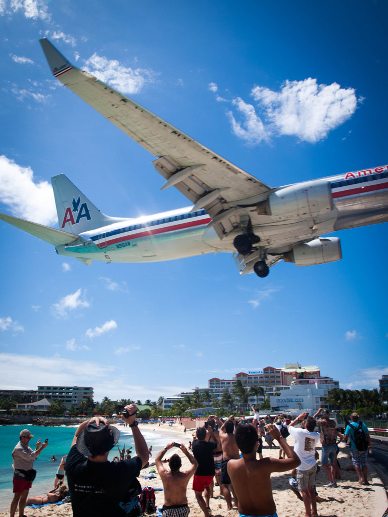 american airlines jet above maho beach st. maarten photos