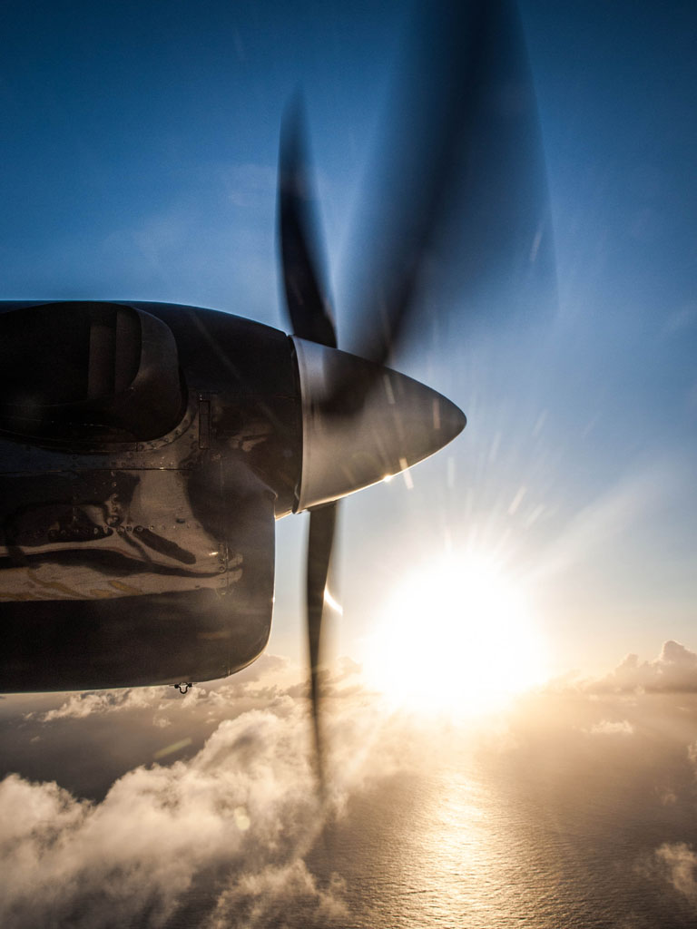 propeller plane view above caribbean sea sunset