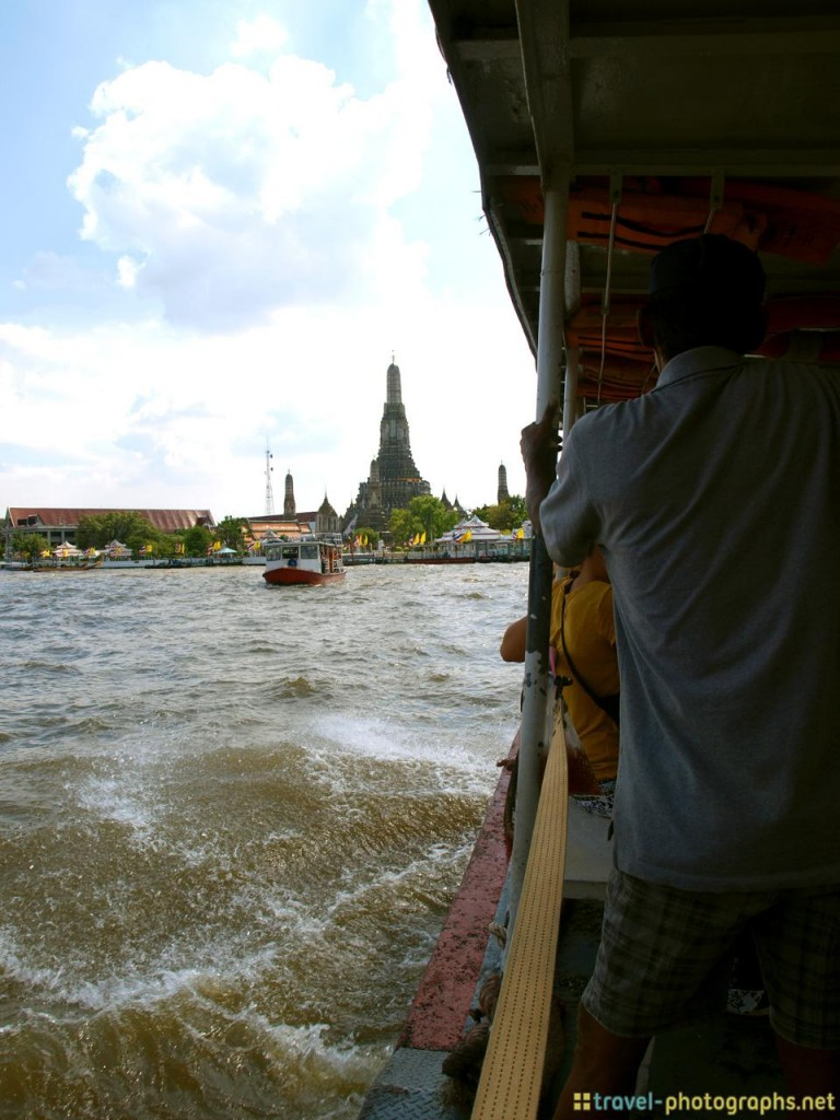 wat arun seen from ferry ride across chao phraya